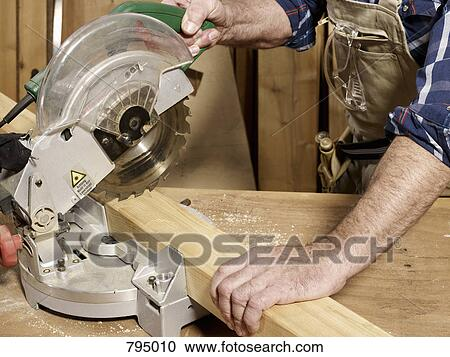 Stock photography detail of a man cutting wood fotosearch search