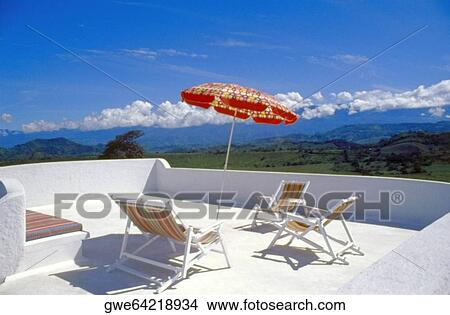Stock foto versieren stoelen met een terras paraplu op een terras gwe64218934 zoek - Terras versieren ...