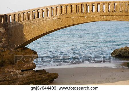 stock photo of arch bridge on the beach le basta biarritz france gwj37044403 search stock. Black Bedroom Furniture Sets. Home Design Ideas
