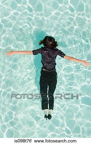 Stock Photography Of Woman Face Down In Swimming Pool