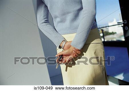 Stock Photograph of Businesswoman looking out office window is109 ...