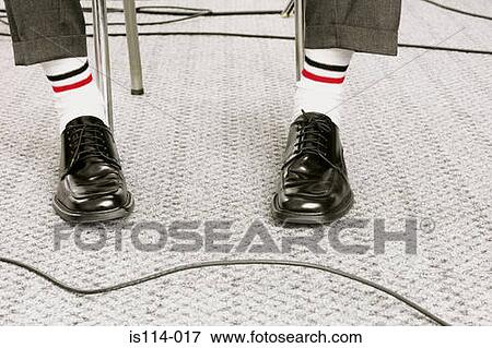 picture of dressed in white socks and black shoes