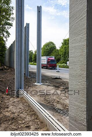 Post Bredeney stock image of construction of noise barriers on the a52 motorway