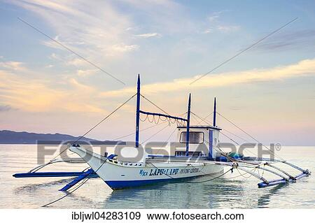 Stock Photograph of Bangka outrigger boat at sunrise on White ...