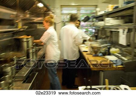 Restaurant Kitchen Photography stock photograph of team of restaurant kitchen staff busy at work