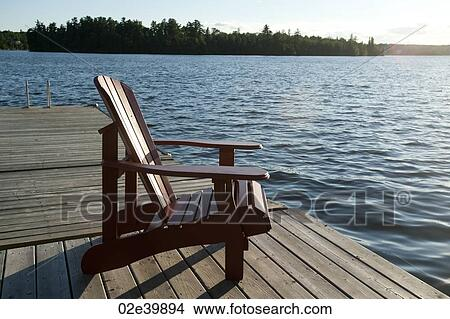 of Muskoka chair on the dock overlooking the lake at Lake of the Woods