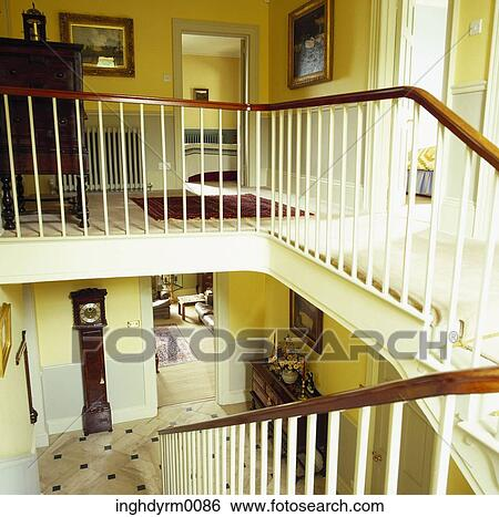 Stock Image   Hand Railing Along A Flight Of Stairs Inside A House.  Fotosearch