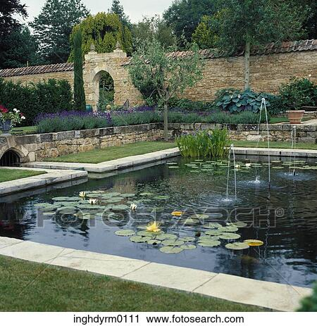 Stock photography of view of an artificial pond with lily for Artificial pond in garden