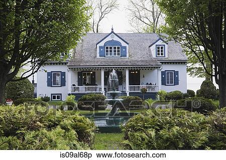 Archivio immagini bianco con assetto blu 1920s for Architettura in stile cottage
