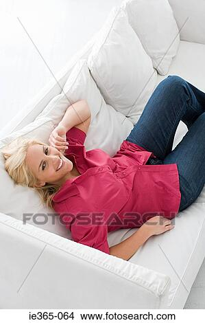Stock Photo Of A Young Woman Reclining On A Sofa Ie365 064