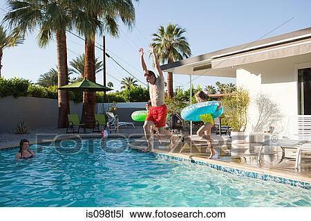 Stock photo of family and outdoor swimming pool is098tl5l for Outdoor pool sculptures