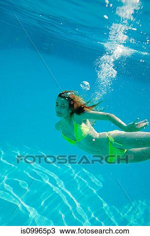 Stock Photo Of Young Woman Swimming Underwater In Swimming