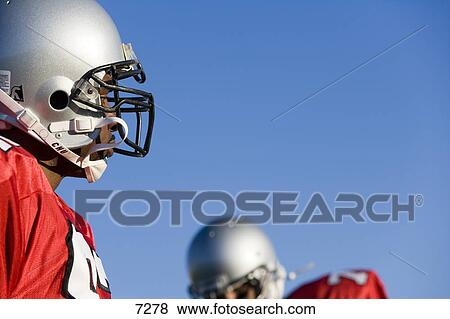 Pictures of Two American football players wearing red ...