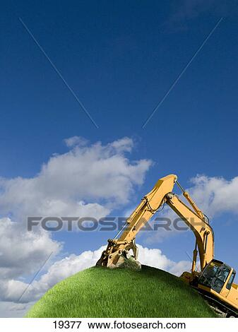 Picture of Excavator digging on grassy globe 19377 ...