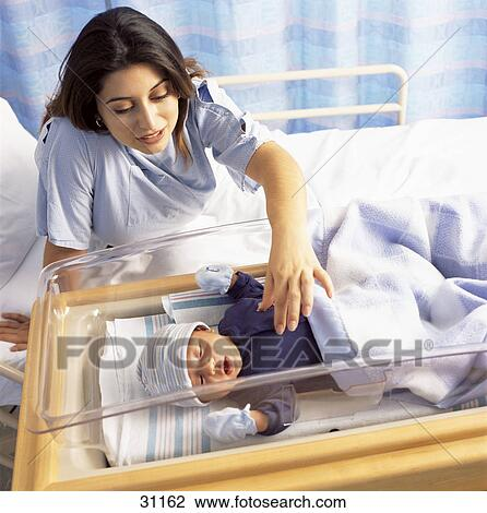 Newborn Baby Boy In Crib