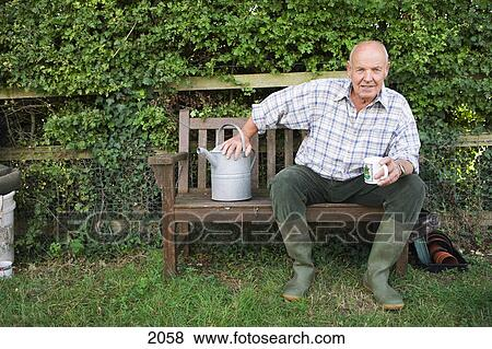 Pictures of senior man in wellington boots sitting on for House sitter wellington
