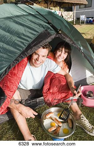 Pictures Of Couple Sitting Inside Dome Tent Man Cooking