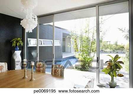 Modern Dining Room Overlooking Swimming Pool