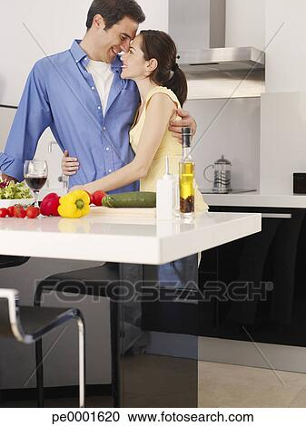 banques de photographies couple pr paration repas ensemble dans moderne cuisine pe0001620. Black Bedroom Furniture Sets. Home Design Ideas