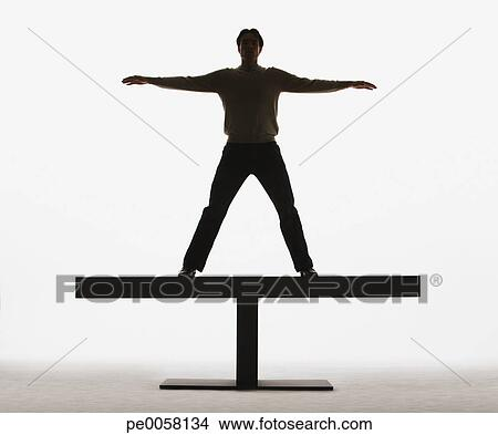 Stock Photo - Man standing on a plank with arms out. Fotosearch ...