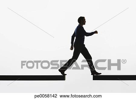 Stock Photo - Man walking from a plank onto another plank. Fotosearch ...