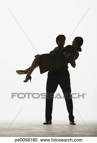 Stock image man holding a woman in his arms fotosearch search