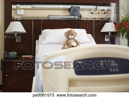 Stock Photo of Empty hospital bed with teddy bear on it ...
