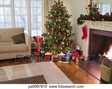 Stock Photography   Gifts Under Christmas Tree In Living Room. Fotosearch    Search Stock Photos Part 26