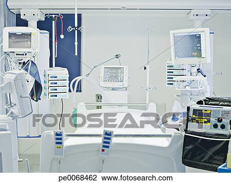 Stock Photo of Empty hospital bed in intensive care ...