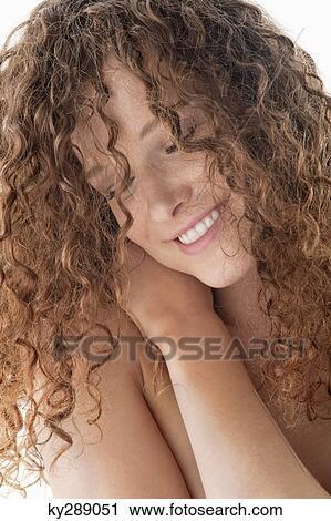naked girl hugging herself