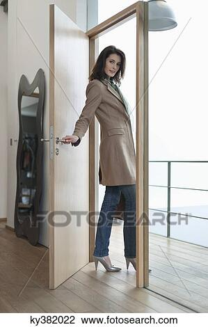 Stock Photo Of Woman Closing The Door Of A House Ky382022