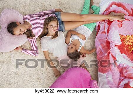Stock Photo Of Girls Sleeping On A Carpet At A Slumber