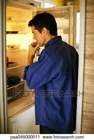 Stock Photography Of Man Standing In Front Of Open