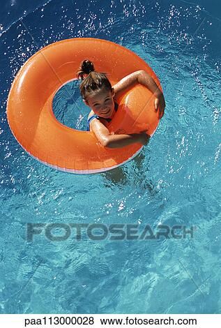 Pictures Of Young Girl Floating In Inner Tube In Pool