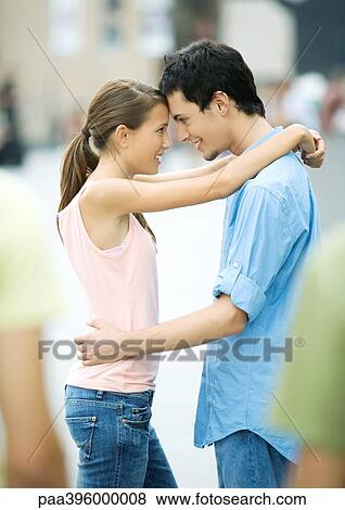 Charming message casual teen couple standing consider