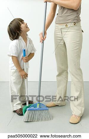 Stock Photo Of Little Boy Helping His Mother Sweep The
