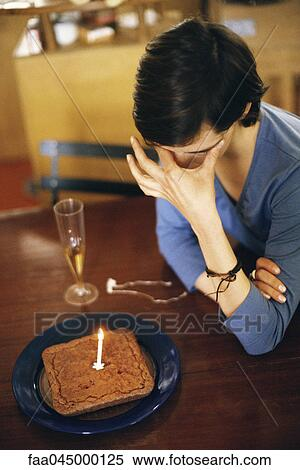 High Angle View Of Person Sitting By Birthday Cake