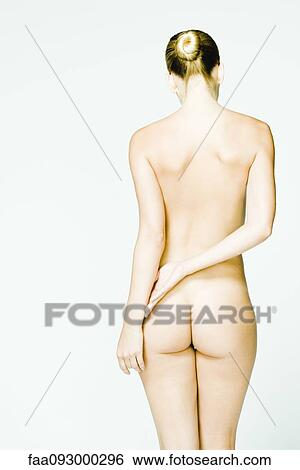 Nude girl standing with hands on hips