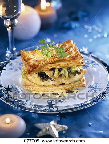 ... flaky pastry with caviar and champenoise sauce View Large Photo Image