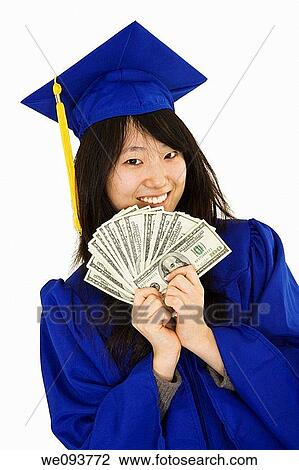 Stock Photo of An Asian teenage in blue graduation gown and ...