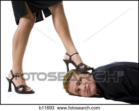 Woman Stepping On Man Stock Photo of Woman s...