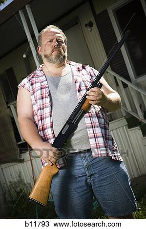 Stock Photo of Overweight man with a shotgun b11793 - Search Stock Images, Poster Photographs ...