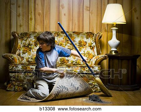 Pictures Of Boy Sweeping Dirt Under Rug B13308 Search