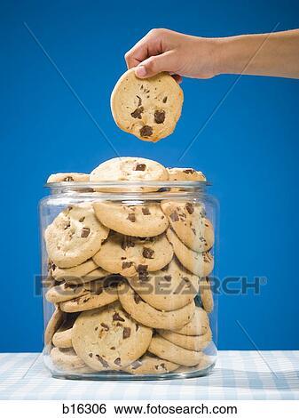 Kids Grabbing Cookies From The Cookie Jar Clip Art