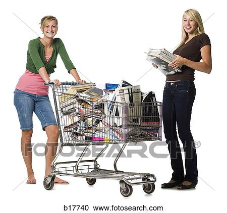 stock fotografie zwei jugendliche m dchen mit einkaufswagen gef llt mit buecher und. Black Bedroom Furniture Sets. Home Design Ideas