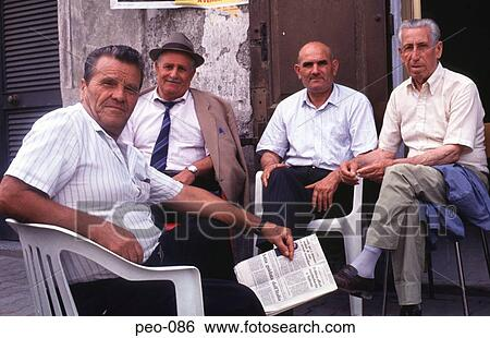 stock images of group of italian men sitting and watching peo 086 group of italian men sitting and watching