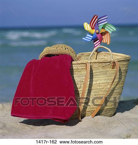 banque de photo chapeau oc an plage sac serviette nature morte pinwheel 1417r 162. Black Bedroom Furniture Sets. Home Design Ideas