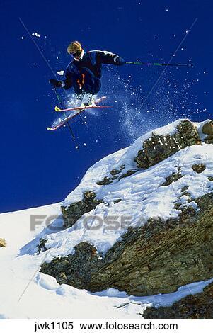 stock image of skiing at snowbird ski resort in utah near