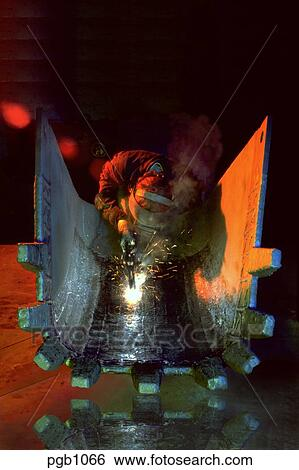 Stock Images Of Welder Welding A Hard Surface Onto The