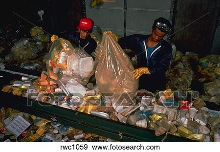 Stock Photograph Of Workers Open Trash Bags Containing